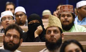 Delegates listen to Indian Prime Minister Narendra Modi's speech during the inauguration of World Sufi Forum in New Delhi on March 17, 2016. Prime Minister Narendra Modi inaugurated World Sufi Forum, a four-day long event organised by All India Ulama and Mashaikh Board (AIUMB), the apex body of Sufi Dargahs in India.The event will see more than 200 Indian and International delegates, spiritual leaders, scholars, academicians and masters of Sufism, under one roof.  / AFP / Prakash SINGH